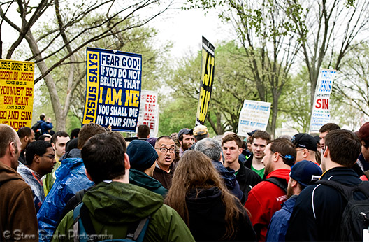 A typical example of how a crowd would form around each sign-toting fundamentalist . Some were there to debate, some were there to watch, and some were there to photograph it.