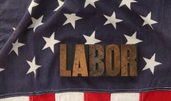 the word labor in old letterpress wood type on an old flag. Image shot 2012. Exact date unknown.